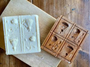 Square butter with flower designs on top from a mold