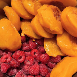Peaches and raspberries ready to be cooked down into jam